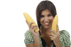 Woman holding two corn cobs. Isolated on white Stock Image