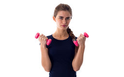 Woman holding two dumbbells Stock Photos