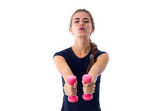 Woman holding two dumbbells Royalty Free Stock Photography