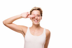Woman holding two fingers at her eye Stock Image
