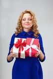 Woman holding two giftboxes Stock Images