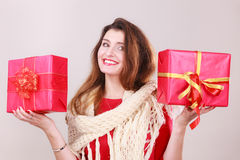 Woman holding two gifts. Stock Photo