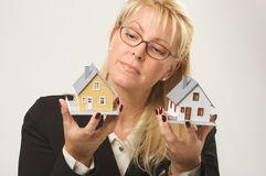 Woman Holding Two Houses Stock Image