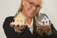 Woman Holding Two Houses royalty free stock photos