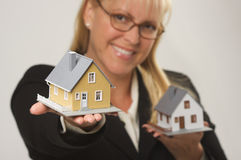 Woman Holding Two Houses Stock Photo