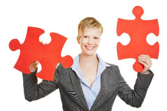 Woman holding two jigsaw puzzle pieces Stock Image