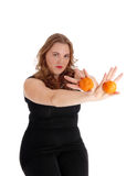 Woman holding two oranges. Stock Photo