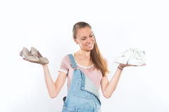 Woman holding two pairs of shoes Royalty Free Stock Photos