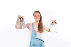 Woman holding two pairs of shoes Royalty Free Stock Image