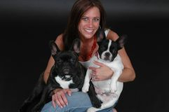 Woman holding two pet dogs Royalty Free Stock Image