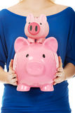 Woman holding two piggybanks. Stock Photography
