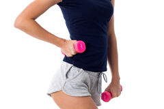 Woman holding two pink dumbbells Royalty Free Stock Image