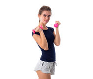 Woman holding two pink dumbbells Stock Photos