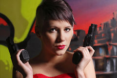 Woman holding two pistols Royalty Free Stock Photo