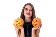 Woman holding two pumpkins Royalty Free Stock Images