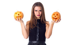 Woman holding two pumpkins Royalty Free Stock Photo