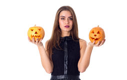 Woman holding two pumpkins Stock Photography