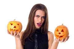 Woman holding two pumpkins Royalty Free Stock Photography