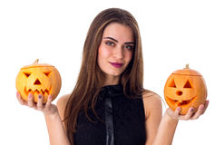 Woman holding two pumpkins Stock Image