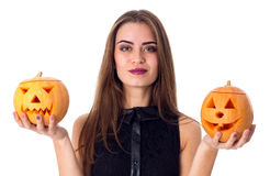 Woman holding two pumpkins Stock Images