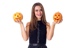 Woman holding two pumpkins Stock Photos