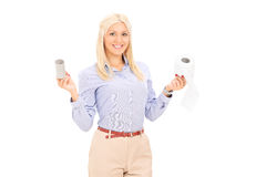 Woman holding two rolls of toilet paper Stock Photos