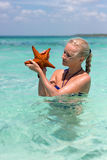 Woman holding two starfishes in her hands Royalty Free Stock Images
