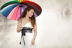 Woman holding umbrella Stock Photo