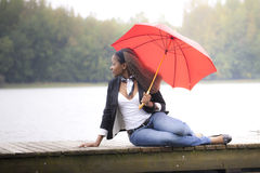 Woman holding an umbrella Stock Photos