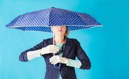 Woman holding an umbrella Stock Image