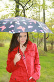 Woman holding a umbrella Stock Photography