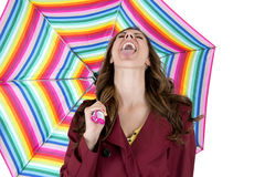 Woman holding umbrella catching rain with tongue Royalty Free Stock Photos
