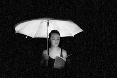 Woman Holding an Umbrella Greyscale Photo Stock Photo