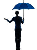 Woman holding umbrella palm gesture silhouette Royalty Free Stock Photos