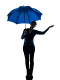 Woman holding umbrella palm gesture silhouette Royalty Free Stock Photography