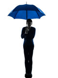 Woman holding umbrella pouting silhouette Royalty Free Stock Images
