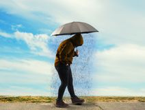 Holding umbrella in the sun Royalty Free Stock Photo