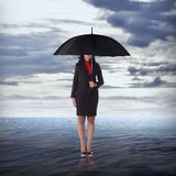 Woman Holding Umbrella In The Sea Stock Images