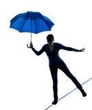 Woman holding umbrella silhouette Stock Photography