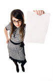 Woman holding up a blank Royalty Free Stock Photos