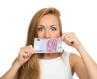 Woman holding up cash money five hundred euro in one note in han Royalty Free Stock Images