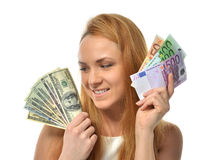 Woman holding up cash money five one fifty hundred euro in one h royalty free stock image