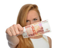 Woman holding up cash money five thousand russian rubles note in. Happy young woman holding up cash money five thousand russian rubles note in hand looking at Royalty Free Stock Image