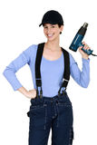 Woman holding up an electric screwdriver Royalty Free Stock Photos