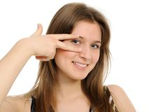Woman holding up fingers and peeking between them Royalty Free Stock Photography