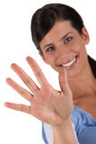 Woman holding up her hand Stock Images