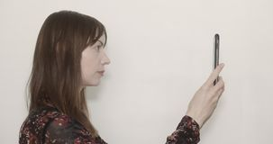 Concept of facial recognition. Woman holding up her mobile device for facial recognition stock video