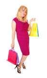 Woman holding up her shopping bags. A pretty woman in her forties holding up the shopping bag's, standing Royalty Free Stock Photography