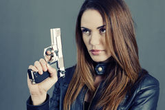 Woman holding up her weapon Royalty Free Stock Photography