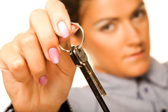 Woman holding up a key Royalty Free Stock Photos